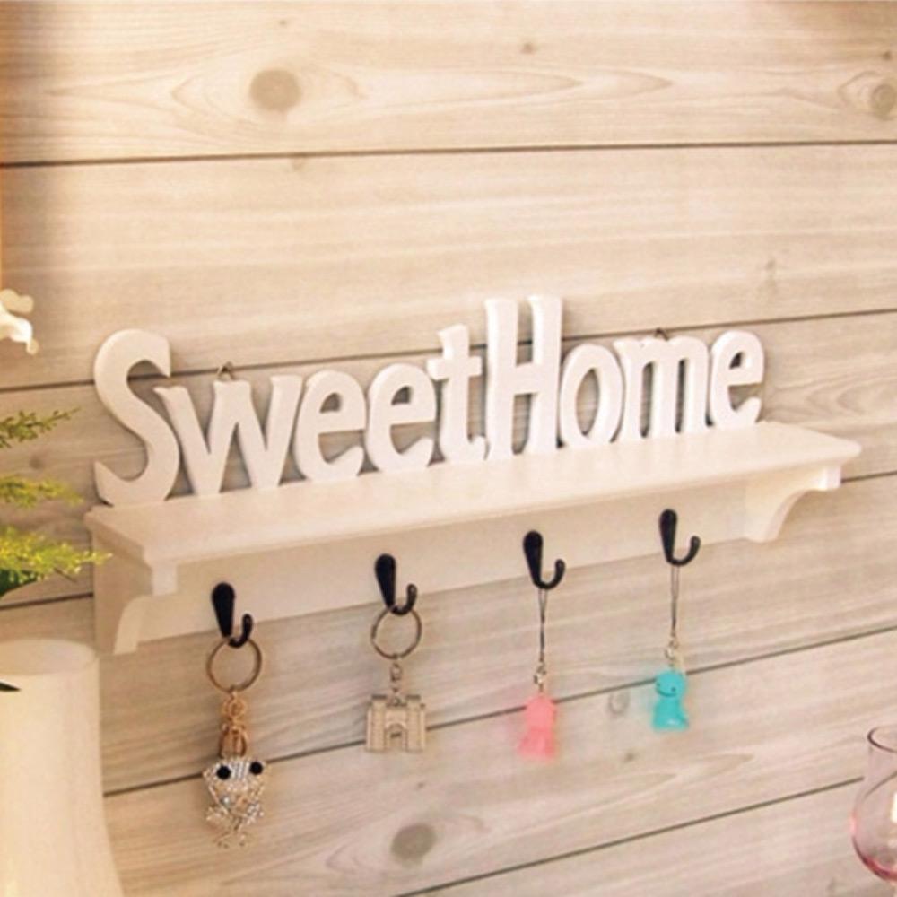 ชั้นตกแต่งผนัง  Sweet home แบบมีที่แขวน สีขาว